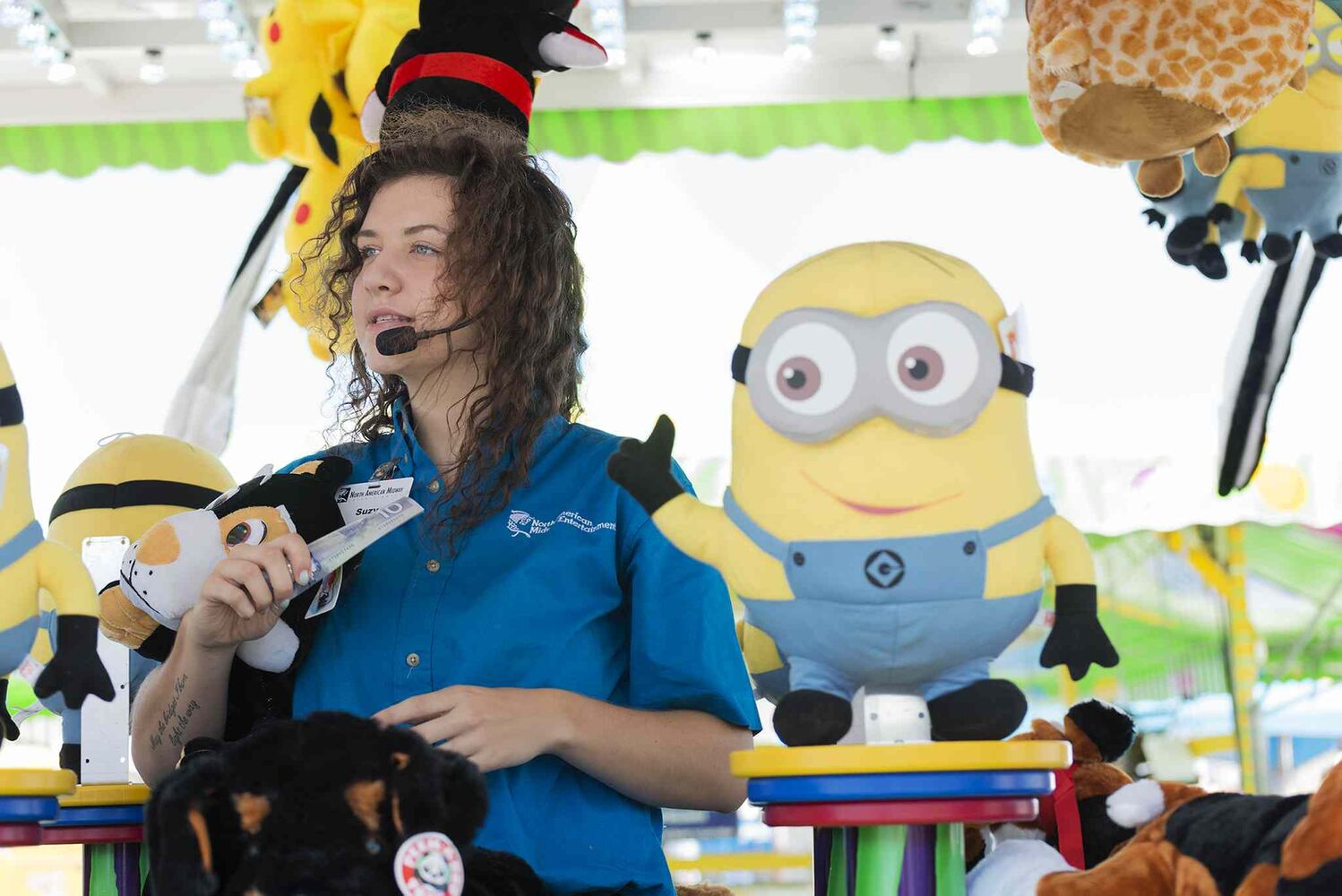 Suzy Willig works the Water Gun Fun game at the Red River Ex.  (Sarah Taylor / Winnipeg Free Press)