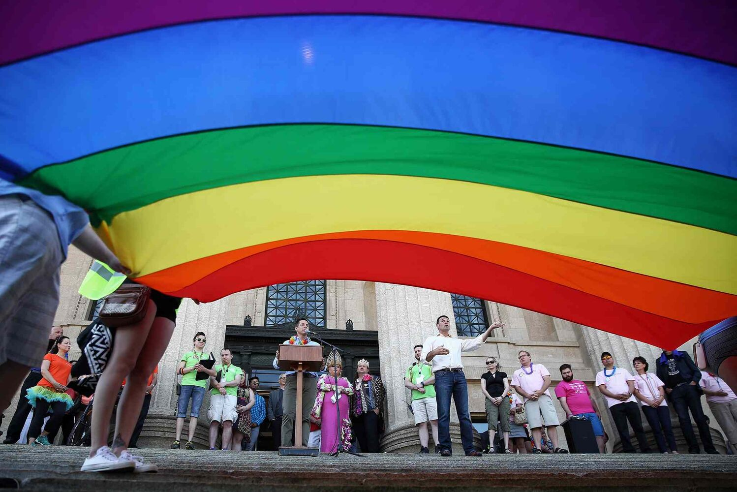 Winnipeg Mayor Brian Bowman speaks to the crowd gathered on the steps of the Manitoba Legislative Building before the Pride Parade Sunday morning.    (MIKE DEAL / WINNIPEG FREE PRESS)