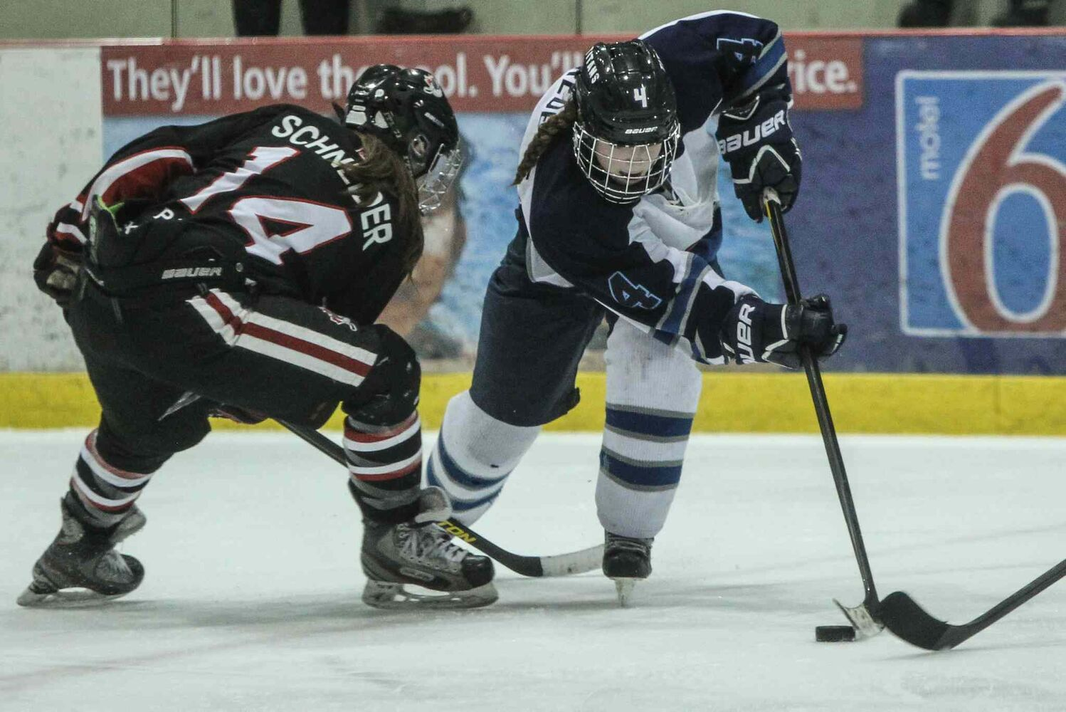 The Shaftesbury Titans' Justine Fredette stickhandles her way around the POEs' Malia Schneider in the third period.
