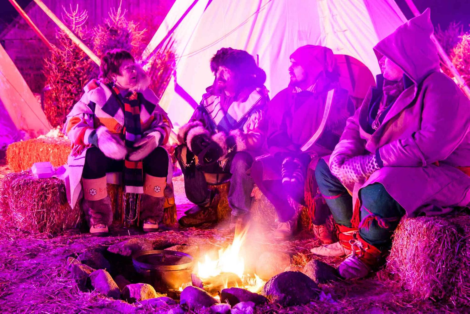 Opening night at the Festival du Voyageur  - Nancy Gouliquer, Tim Gouliquer, Toussaint Arcel, and Jeremy Kingsbury, share stories of past Festivals around the fire. 