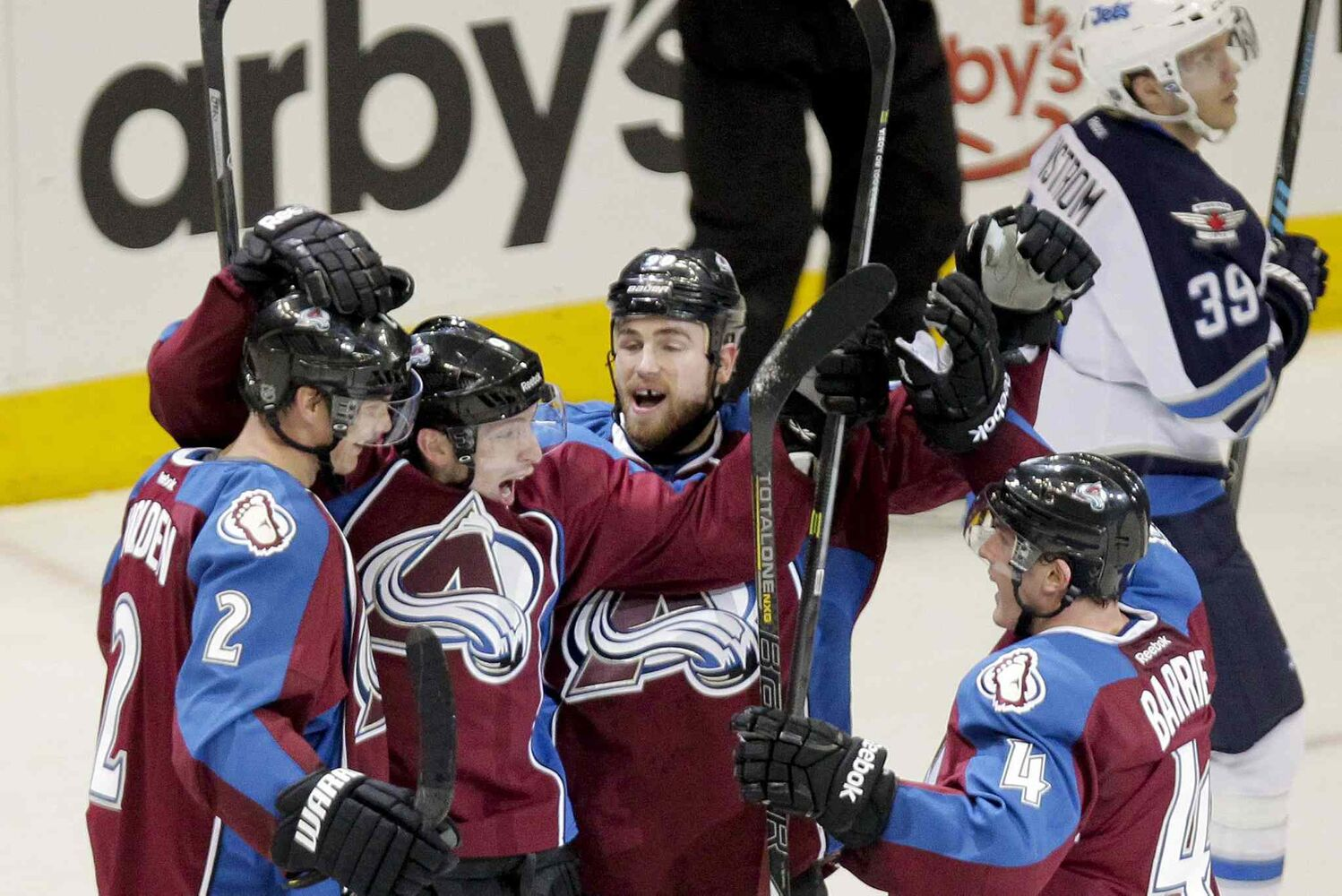 Colorado Avalanche forward Matt Duchene, second from left, celebrates after scoring the game-winning goal past Winnipeg Jets goalie Al Montoya during overtime of an NHL game at the Pepsi Center in Denver, Colo., Monday. The Avalanche won 3-2 to hand the Jets their fourth straight defeat.