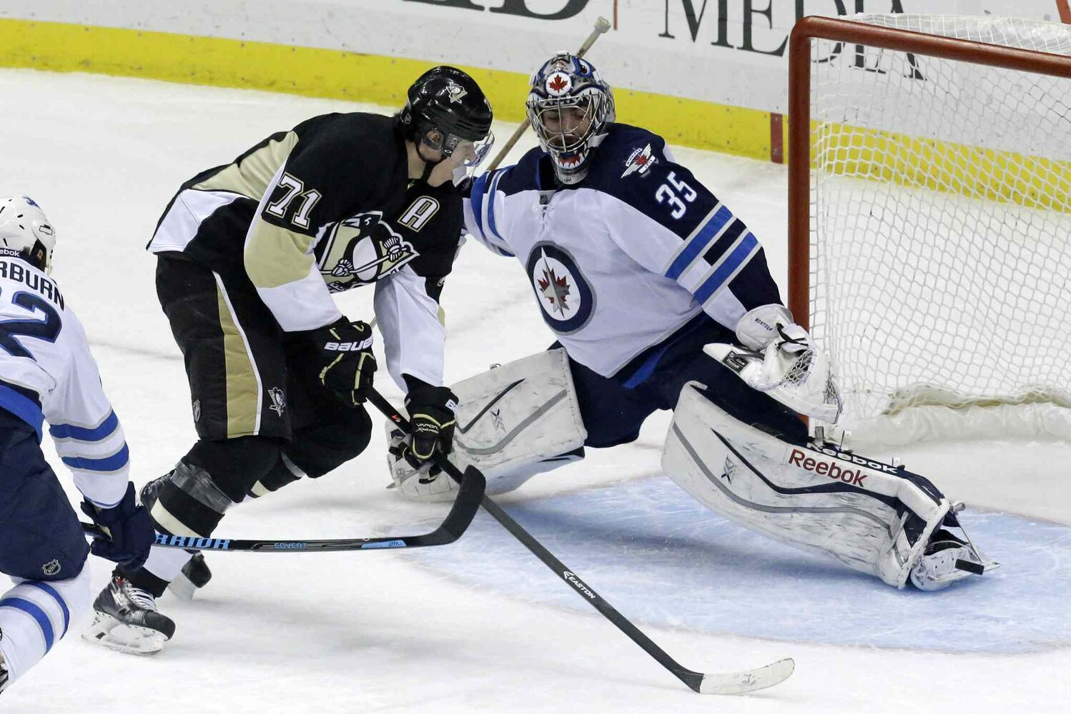 Pittsburgh Penguins' Evgeni Malkin can't get to a rebound in front of Winnipeg Jets goalie Al Montoya during the first period of an NHL game at the Consol Energy Center in Pittsburgh Sunday. The Penguins won 6-5. (GENE J. PUSKAR / THE ASSOCIATED PRESS)