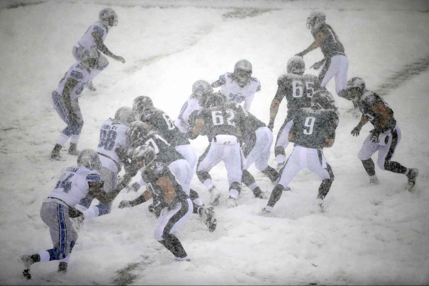 The Philadelphia Eagles and Detroit Lions battle it out in the snow in Philadelphia on Sunday. (Matt Rourke / The Associated Press)