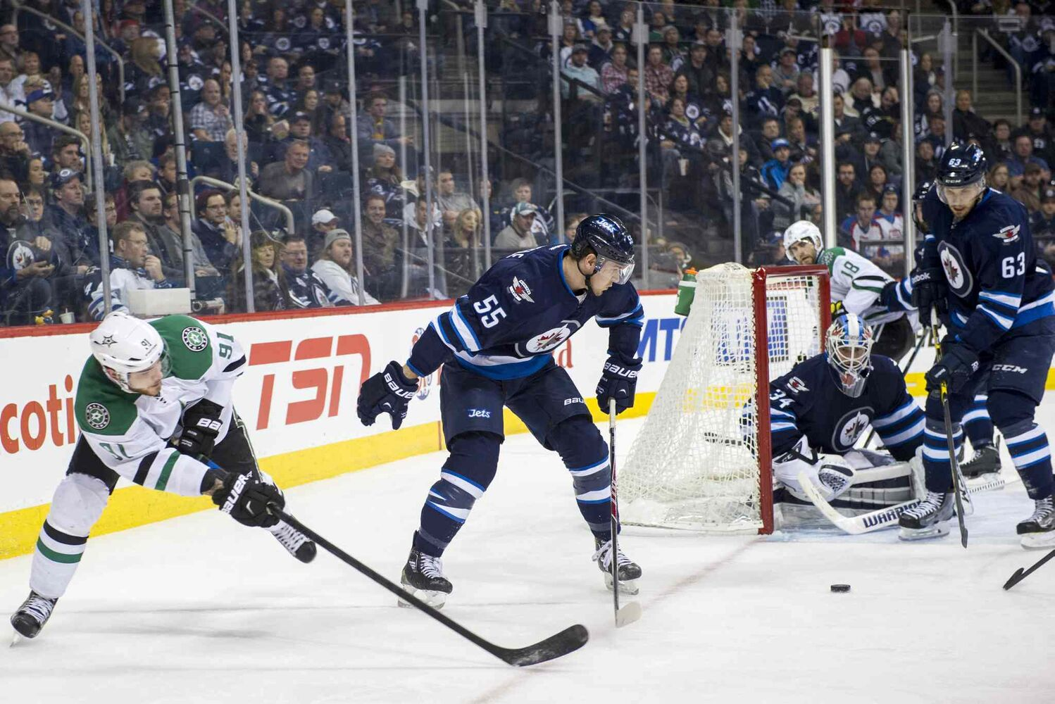 The Jets try to stop a third-period wrap-around shot from Dallas Stars Tyler Sequin (#91). (DAVID LIPNOWSKI / WINNIPEG FREE PRESS)