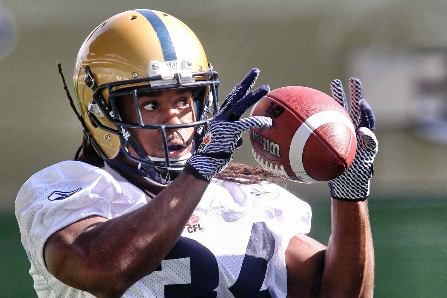 Paris Cotton catches the ball during the first official day of the Winnipeg Blue Bombers training camp at Investors Group Field Sunday morning.   (Mike Deal / Winnipeg Free Press)