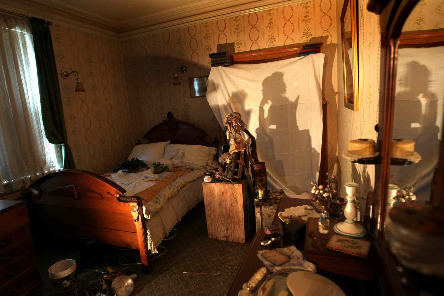 In this 2010 photo, Helga Jakobson's Shadow Play is displayed at Dalnavert Museum as part of Phantasmagoria, a spooky, ghostly show with various artist exhibits showcased in different rooms throughout the house.