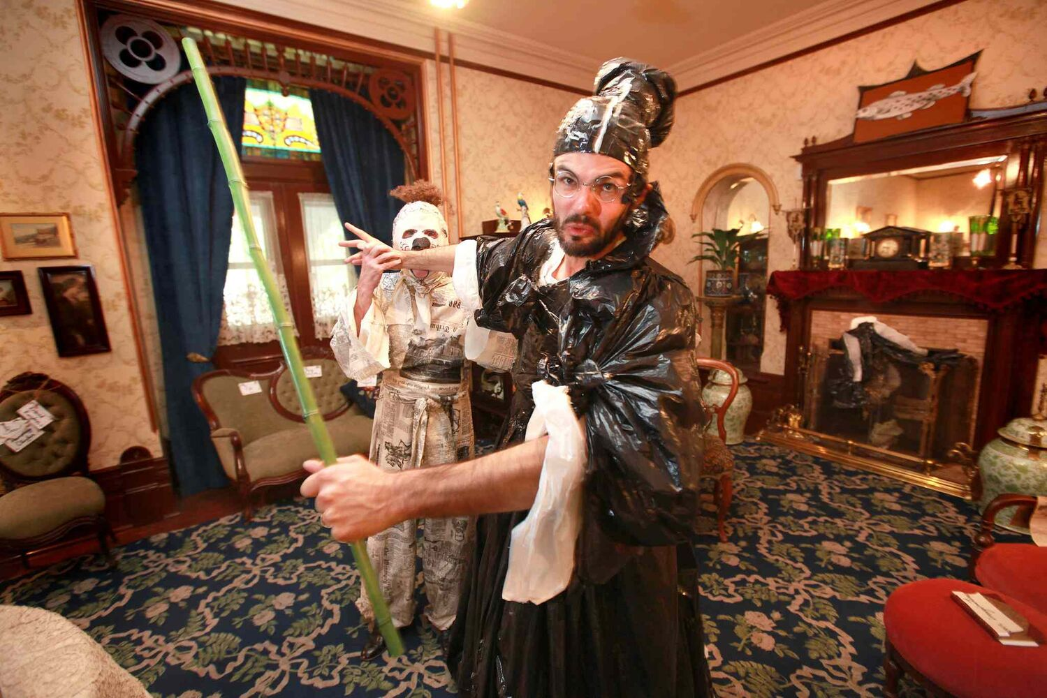 Actors Ian Mozdzen (front) and Doug Melnyk act out a scene from their play 'Dalnavert Copperfield' in this 2012 photo. The play is a performative tour that takes place throughout Dalnavert Museum, and is a mix of Charles Dickens and the real-life history of the museum. (Ruth Bonneville / Winnipeg Free Press archives)