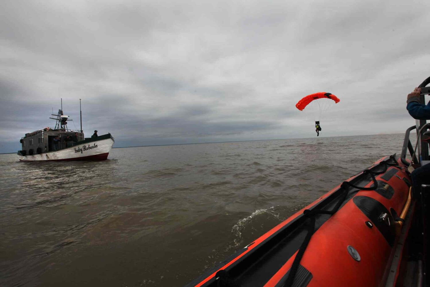 A SAR tech prepares to land in the water near the Lady Roberta.