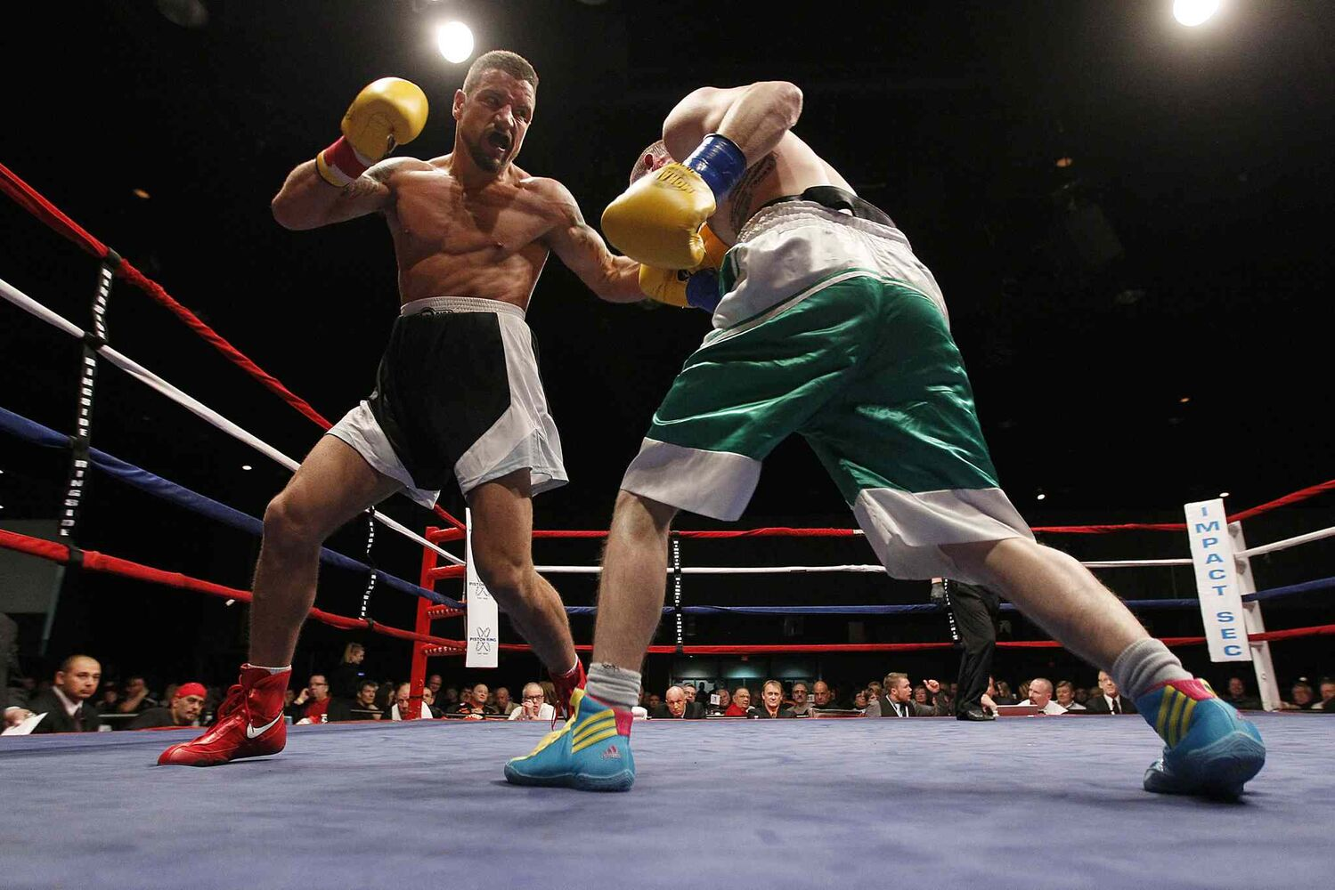 Brad Elsliger (left) hits Paul Bdzel in the midsection. (John Woods / Winnipeg Free Press)
