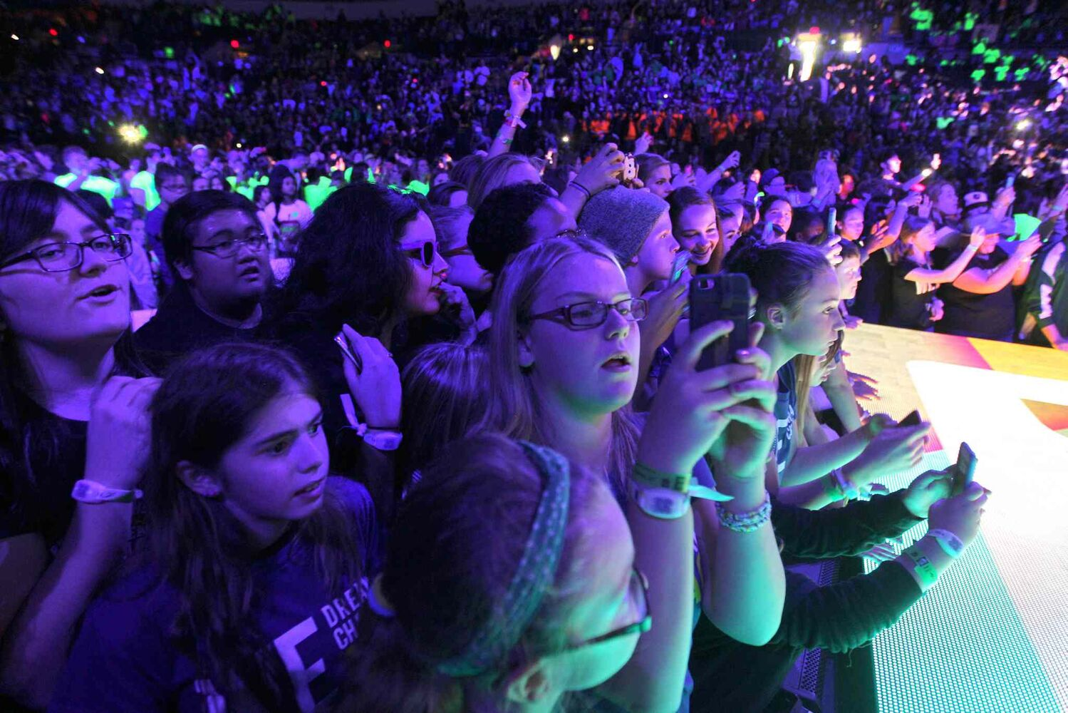 Thousands of students take a picture of the final moments of We Day to upload to social media. (Ruth Bonneville / Winnipeg Free Press)