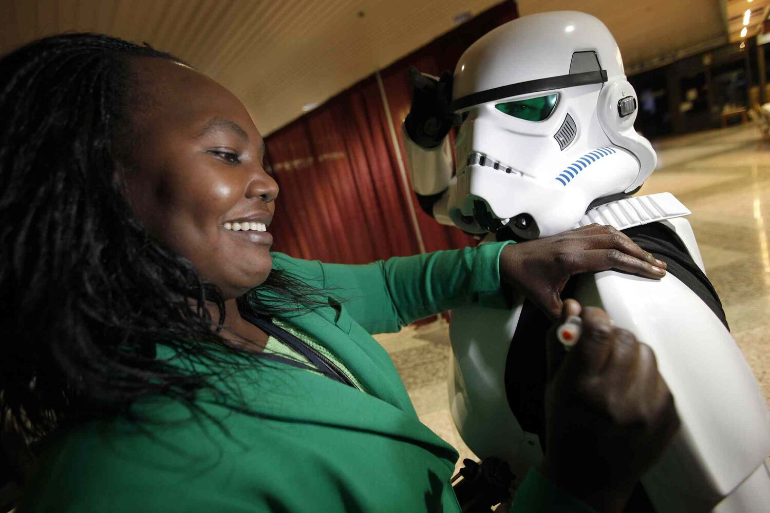 Public health nurse (not a costume) Margaret Juan pretends to give James Antoine, dressed as an Imperial stormtrooper from the Star Wars films, a flu vaccination at the WRHA flu clinic at C4. (John Woods / Winnipeg Free Press)