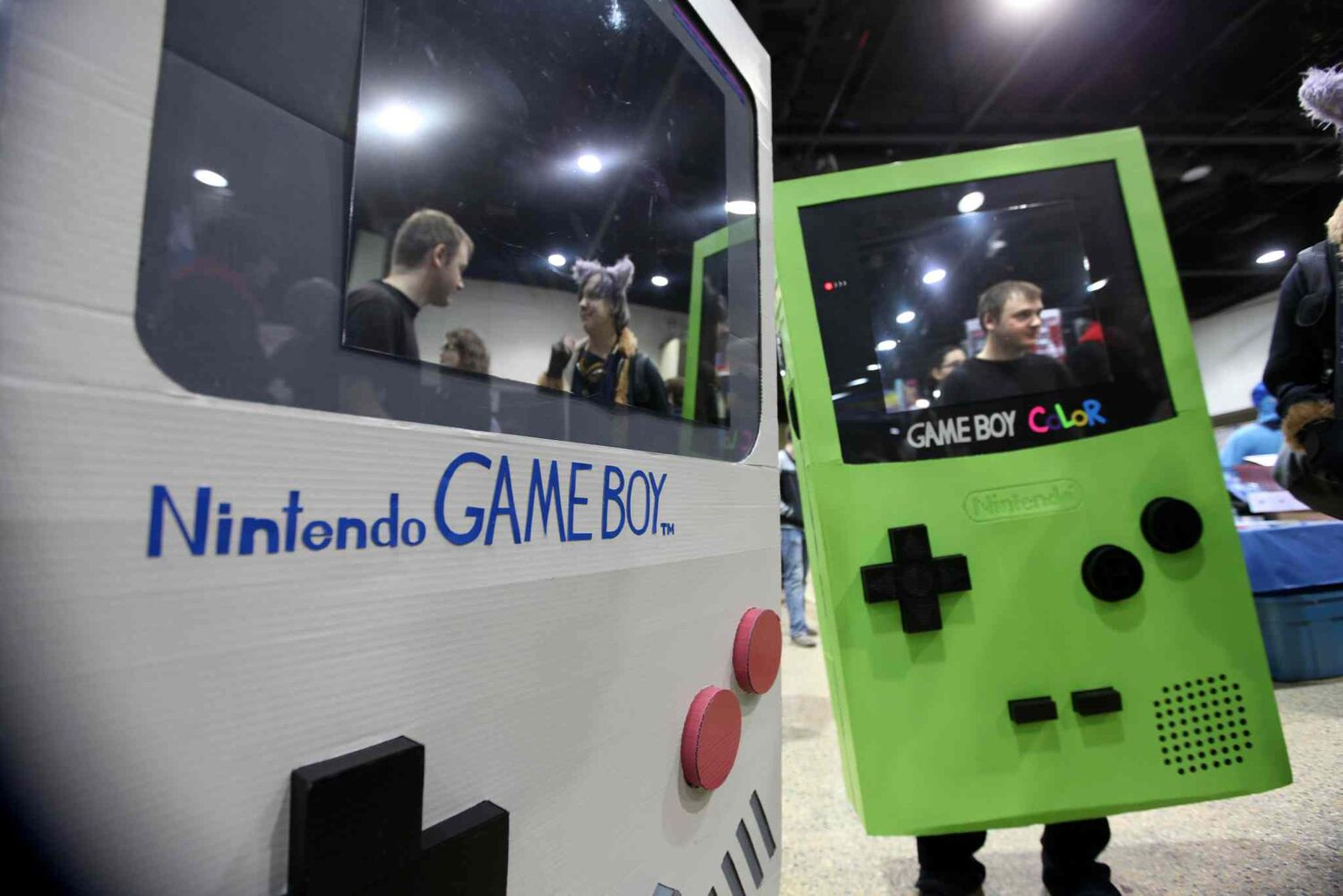 Two attendees sport Nintendo Game Boy costumes. It was unclear whether or not batteries were included.