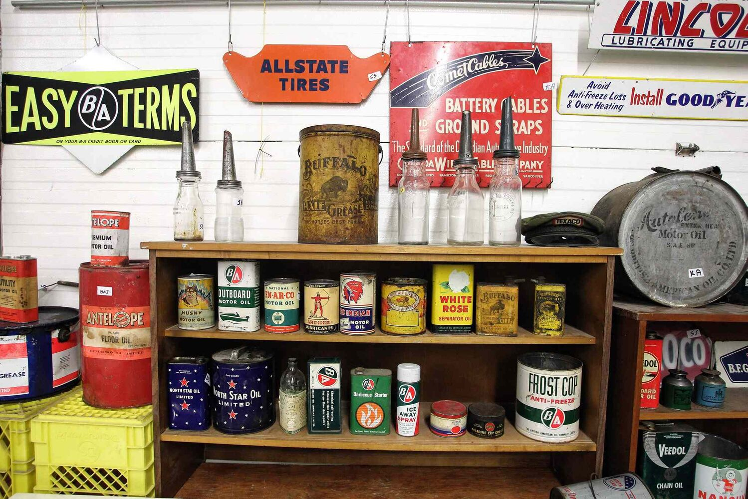 Old canisters of motor oil, axle grease, antifreeze and more are included in the auction.