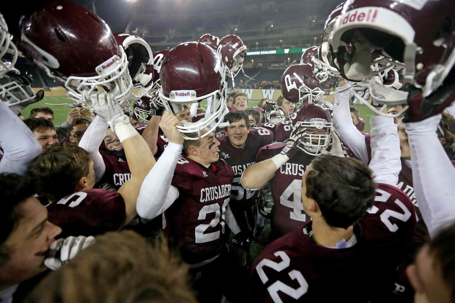 The St. Paul's Crusaders AAA football team celebrates their victory over the Murdoch McKay Clansmen by a score of 56-8 at Investors Group Field. (Trevor Hagan / Winnipeg Free Press)