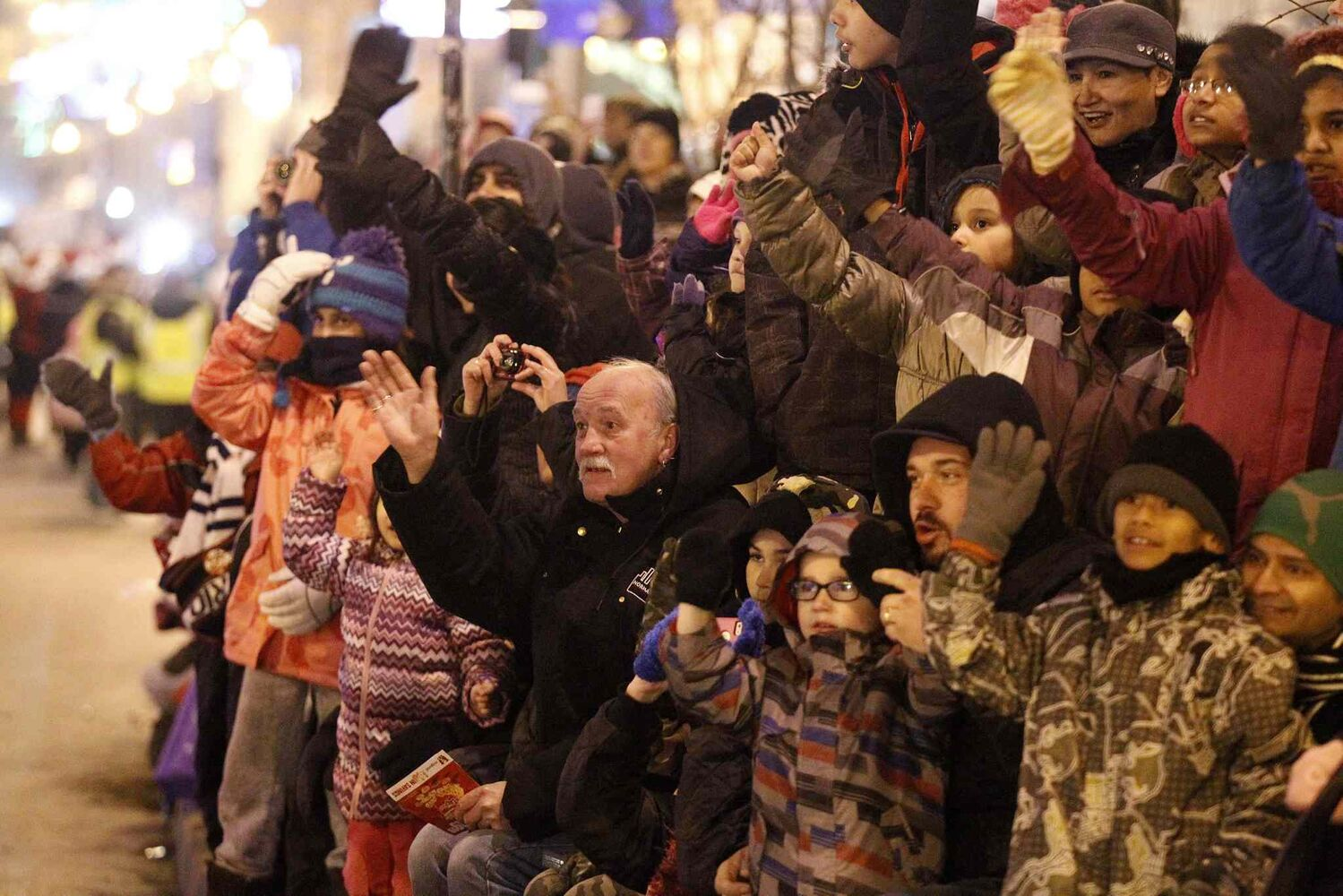 Crowds along Portage Ave. greeted Santa with big smiles and lots of waving. (TREVOR HAGAN / WINNIPEG FREE PRESS)