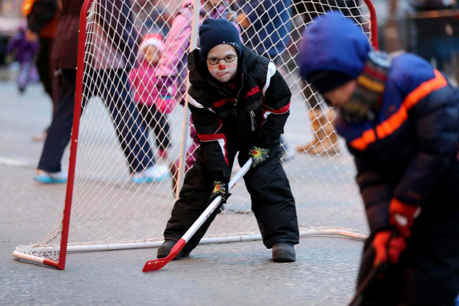 A game of street hockey kept kids busy while waiting for Santa. (TREVOR HAGAN / WINNIPEG FREE PRESS)