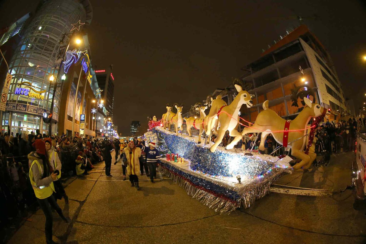 Santa Claus and his float move past the MTS Centre on Portage Ave. (TREVOR HAGAN / WINNIPEG FREE PRESS)