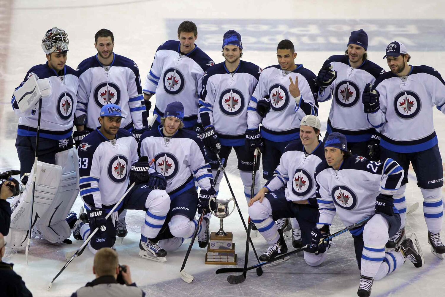 Team White poses with the trophy after winning the Winnipeg Jets Skills Competition at the MTS Centre Wednesday evening. (Boris Minkevich / Winnipeg Free Press)