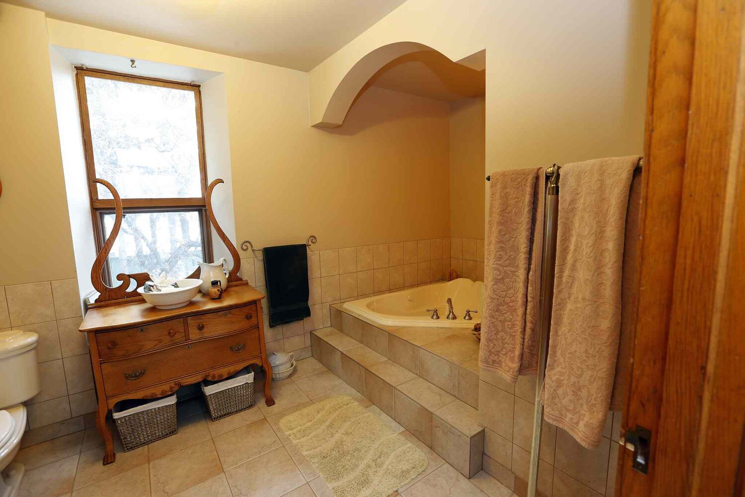 A custom bathroom was designed in keeping with the house's historic feel.