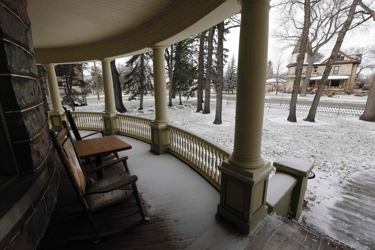 Another historic stone house can be seen from the curved front porch. (KEN GIGLIOTTI / WINNIPEG FREE PRESS)