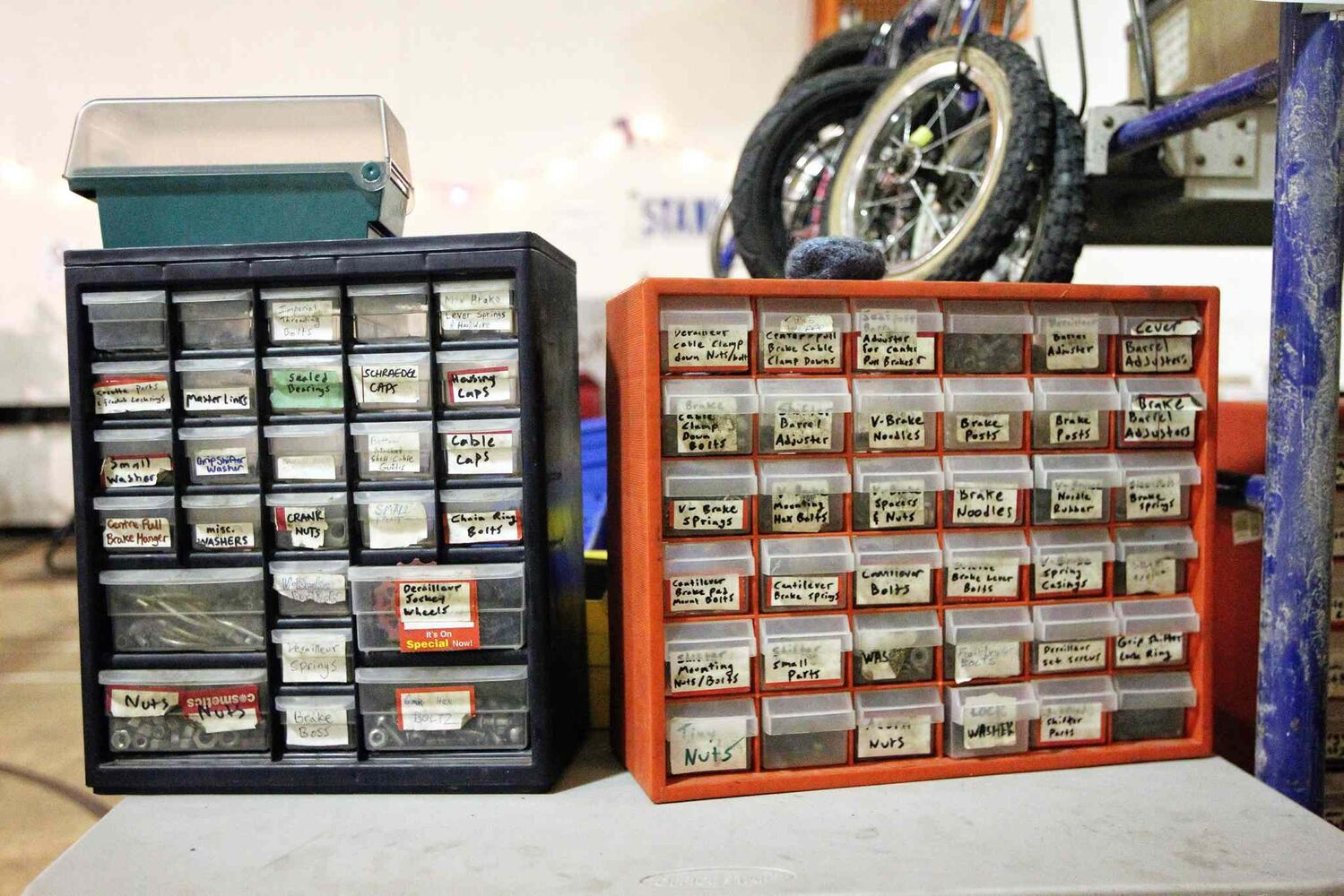 Tool boxes filled with pieces needed to repair bikes sit waiting for volunteers to dig in. (MIKE DEAL / WINNIPEG FREE PRESS)