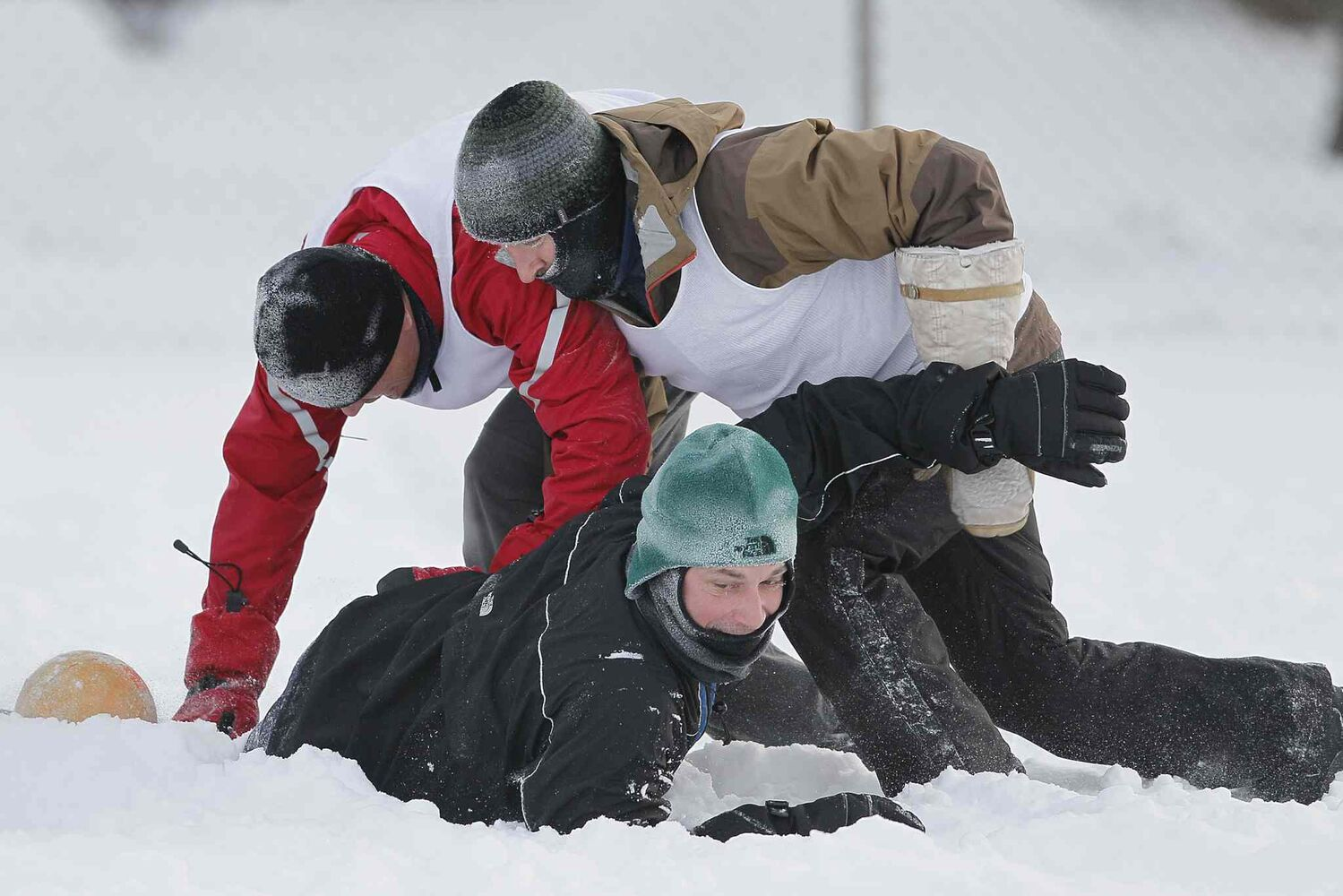 Brett Hudson, Mark Reed, and Mitch Decaire of Sue's Socceroos and Mara's Mountaineers play some soccer in the snow at their annual Snow Bowl at LaVerendrye School Saturday, December 28. (Winnipeg Free Press)