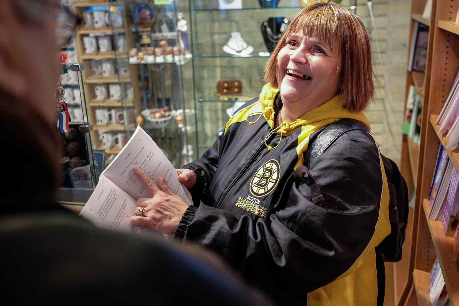 Cathy finds a hockey joke book while browsing the stores at The Forks. MIKE DEAL / WINNIPEG FREE PRESS