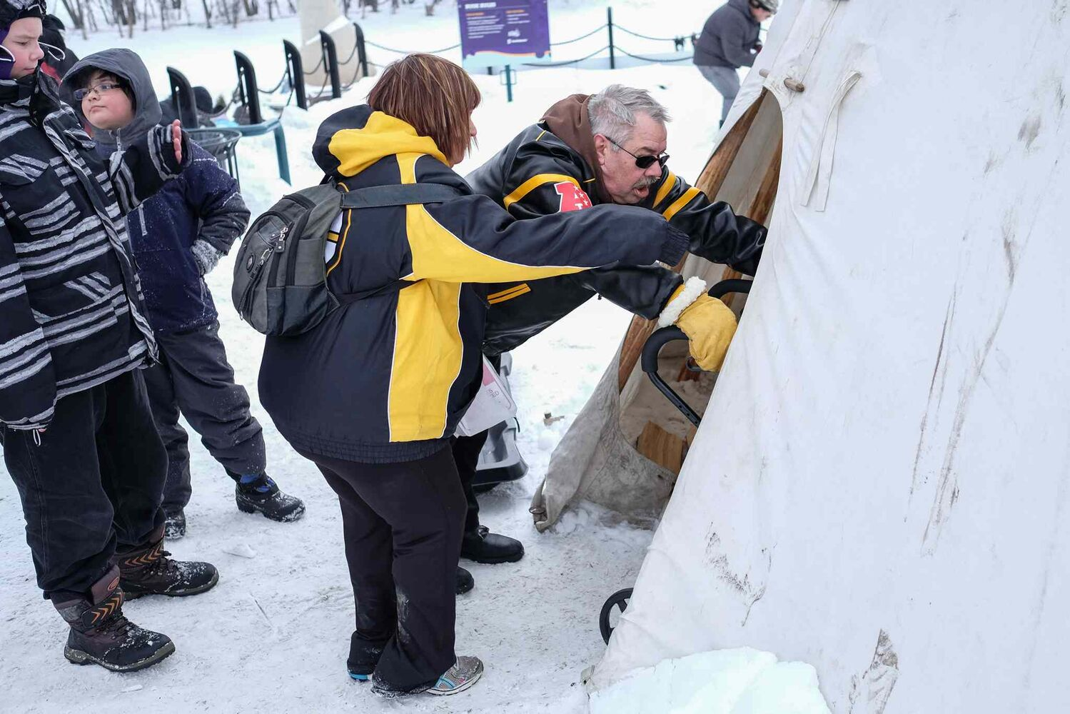 Checking out one of the tee-pee's at The Forks.