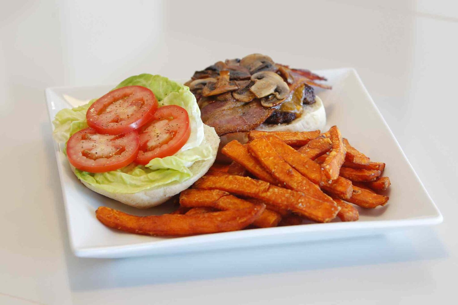 Burger and yam fries at Marion Street Eatery. (BORIS MINKEVICH / WINNIPEG FREE PRESS)