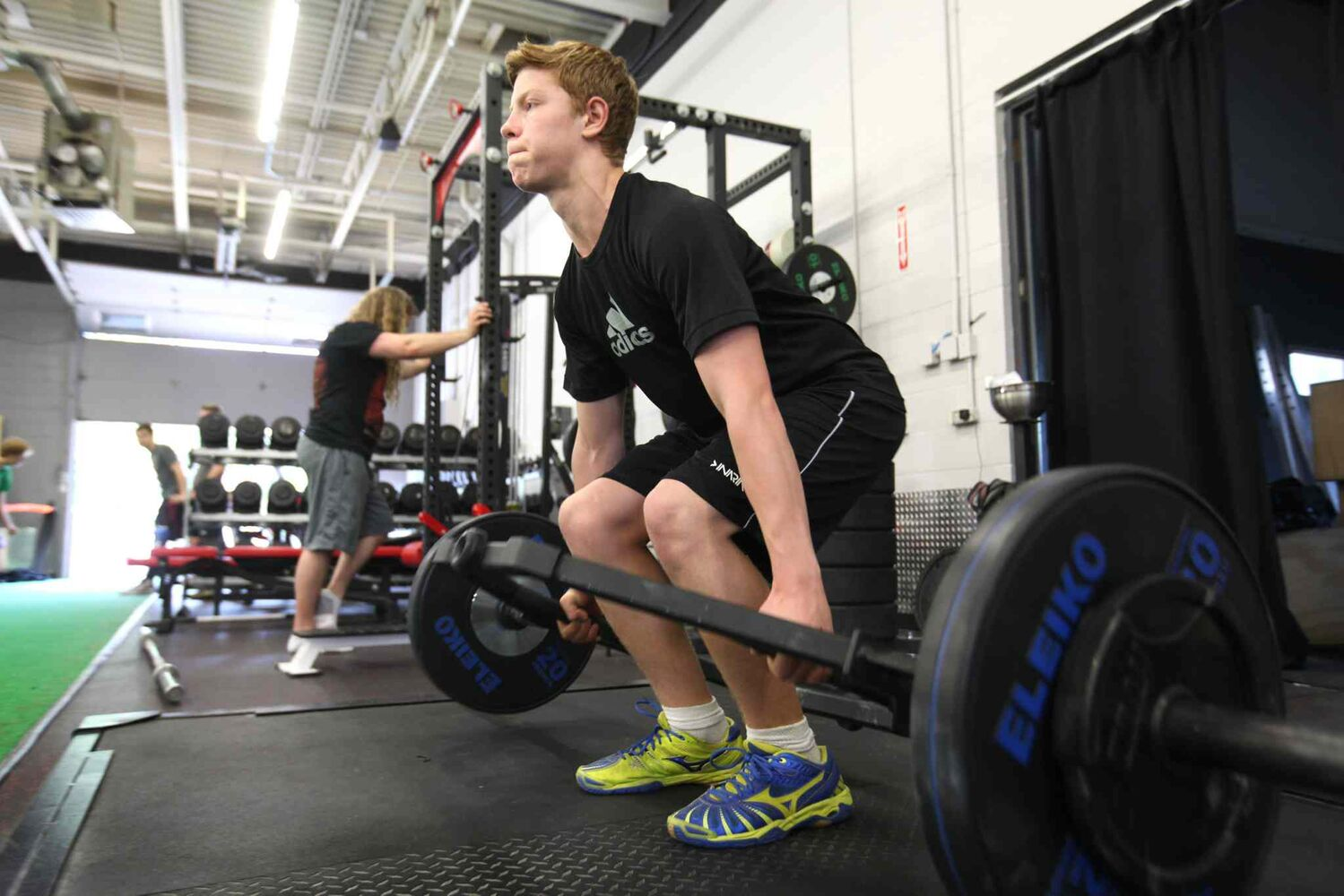 Griffin has started weight training at McDole's Gym after school to keep him in shape for hockey in the off-season.   (RUTH BONNEVILLE / WINNIPEG FREE PRESS)