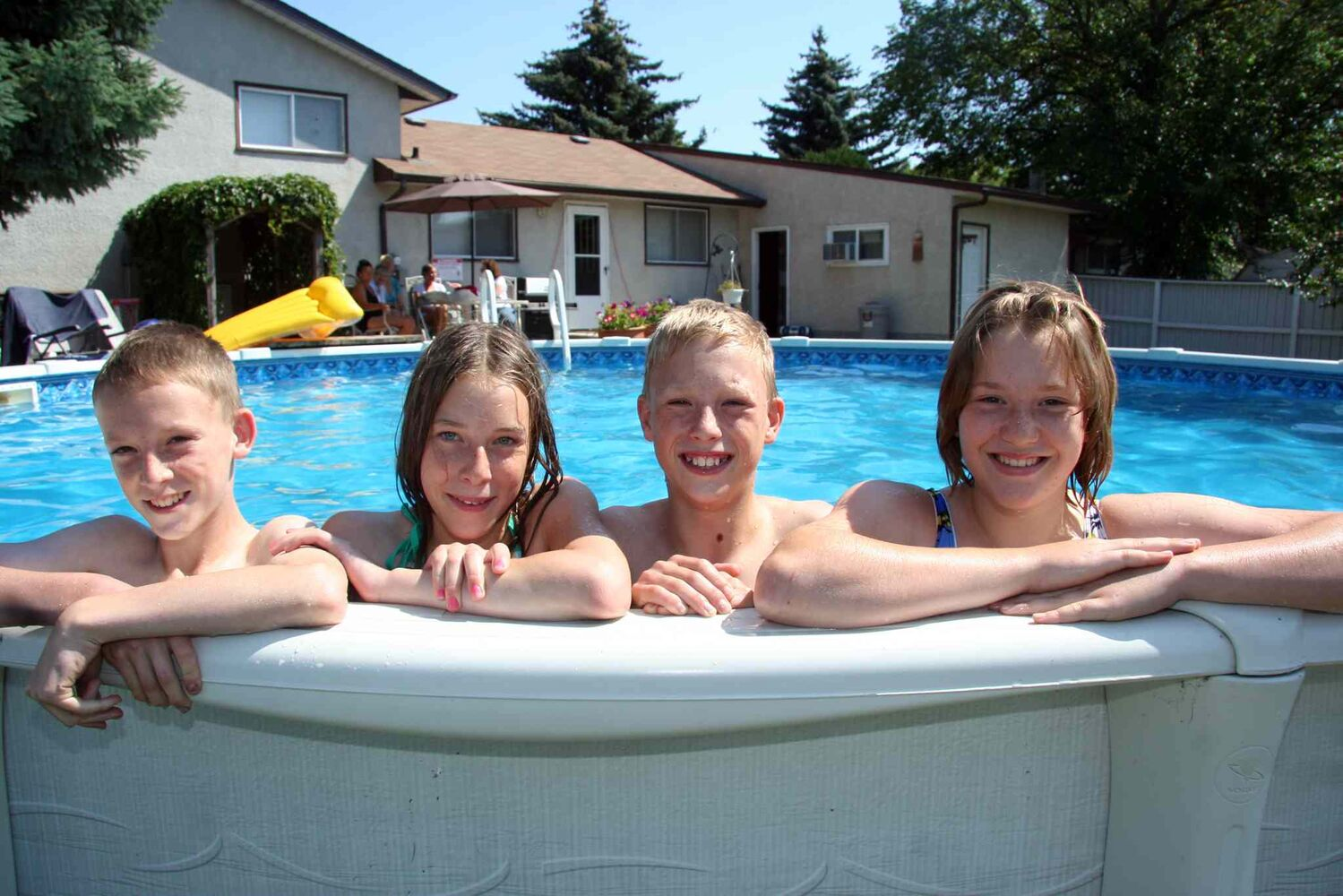 Gregory, left, Maryn, Myles and Janelle, soak up some sun just before their 13th birthday. (Matt Goerzen/Brandon Sun files)