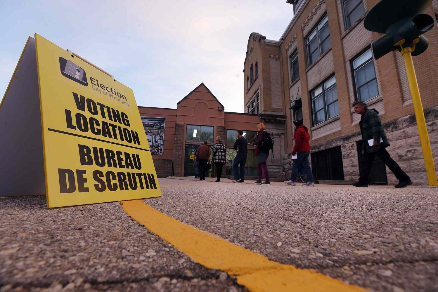About a dozen people lined up before 8 a.m. at Luxton School polling station to vote today. Voting continues at polling stations around the city until 8 p.m.  (KEN GIGLIOTTI / WINNIPEG FREE PRESS)