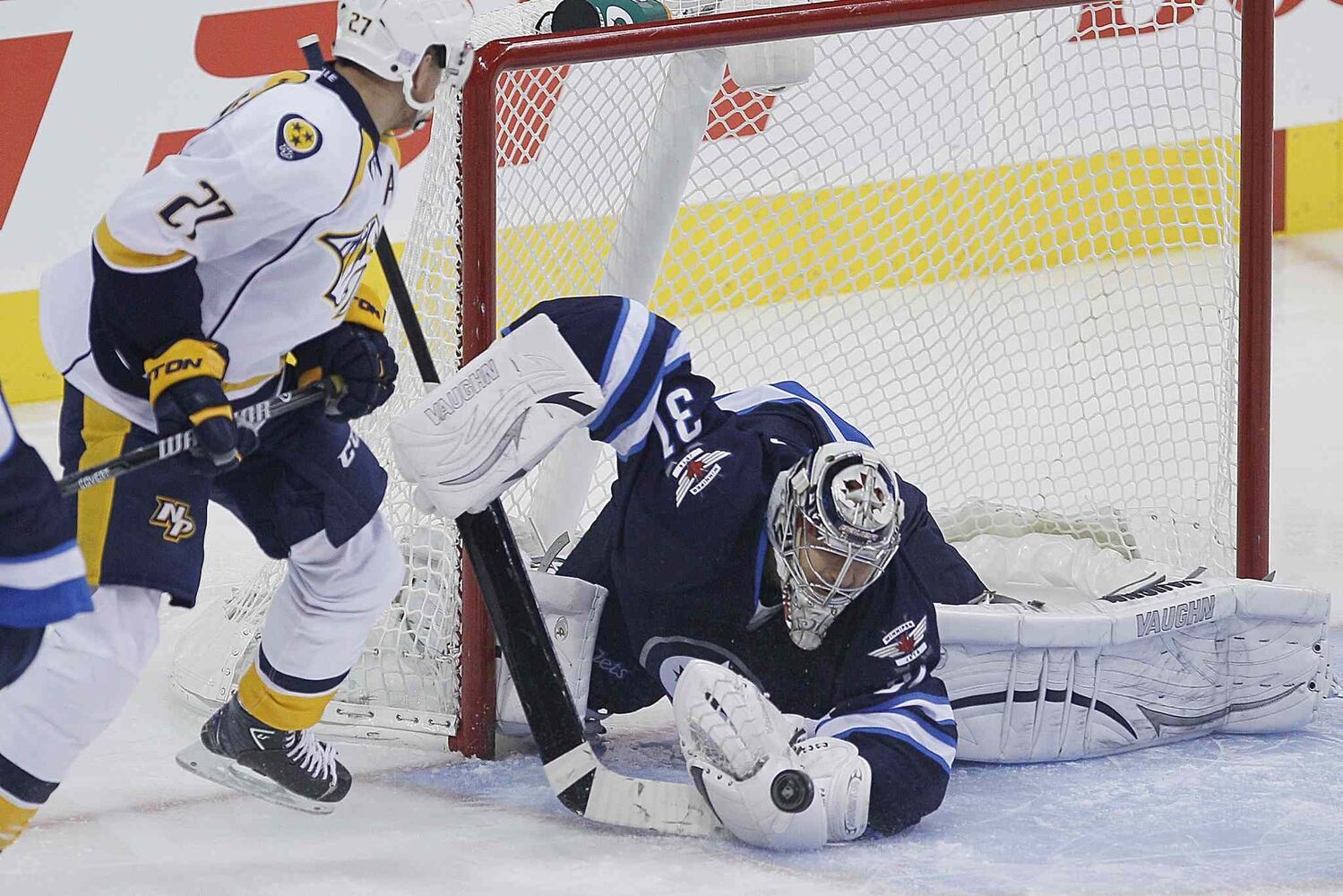 Winnipeg Jets' goaltender Ondrej Pavelec (31) stops the shot as Nashville Predators Patric Hornqvist (27) looks for the rebound during the first period. (JOHN WOODS / WINNIPEG FREE PRESS)