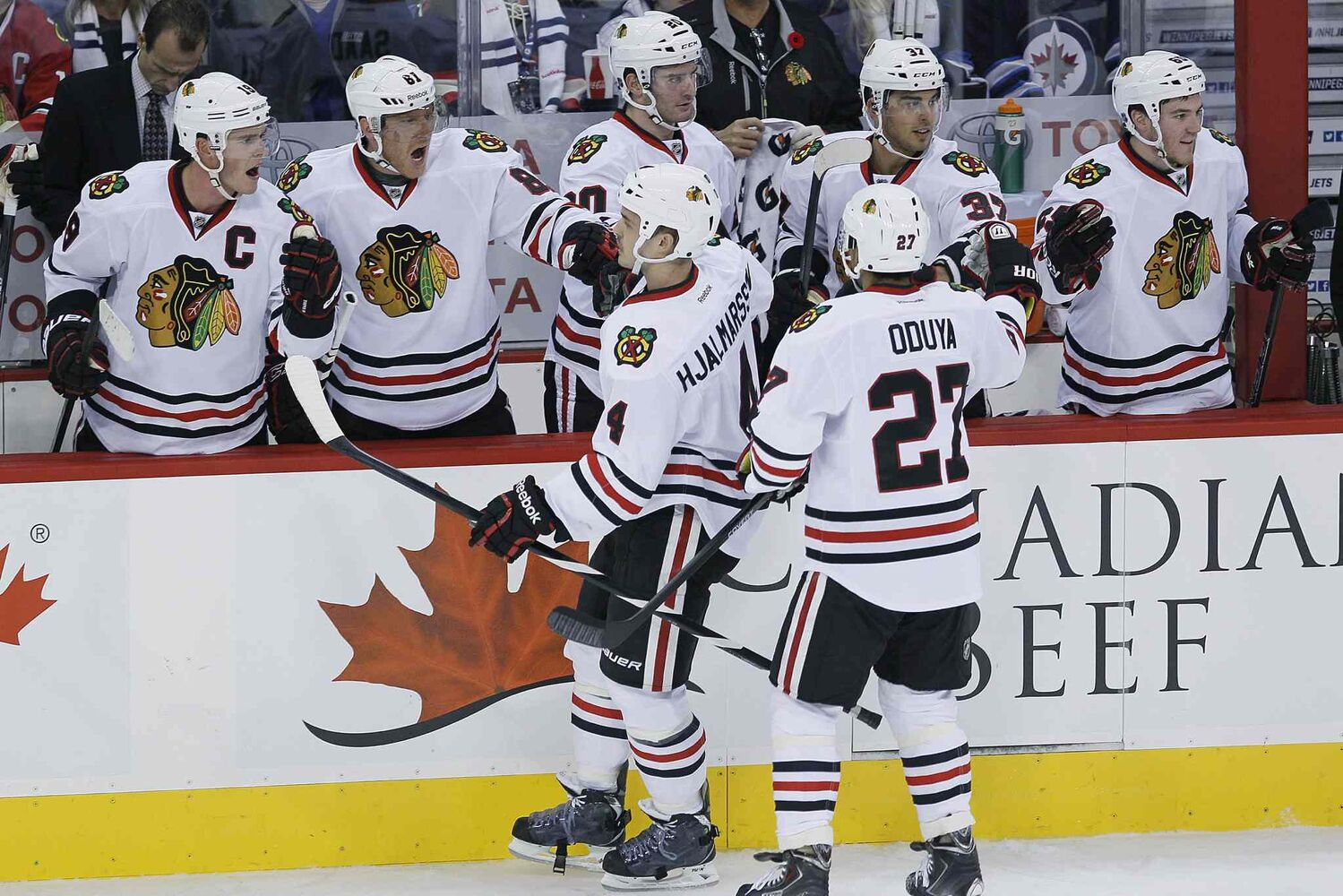 Members of the Chicago Blackhawks celebrate the first-period goal by Niklas Hjalmarsson (bottom left). (John Woods / The Canadian Press)