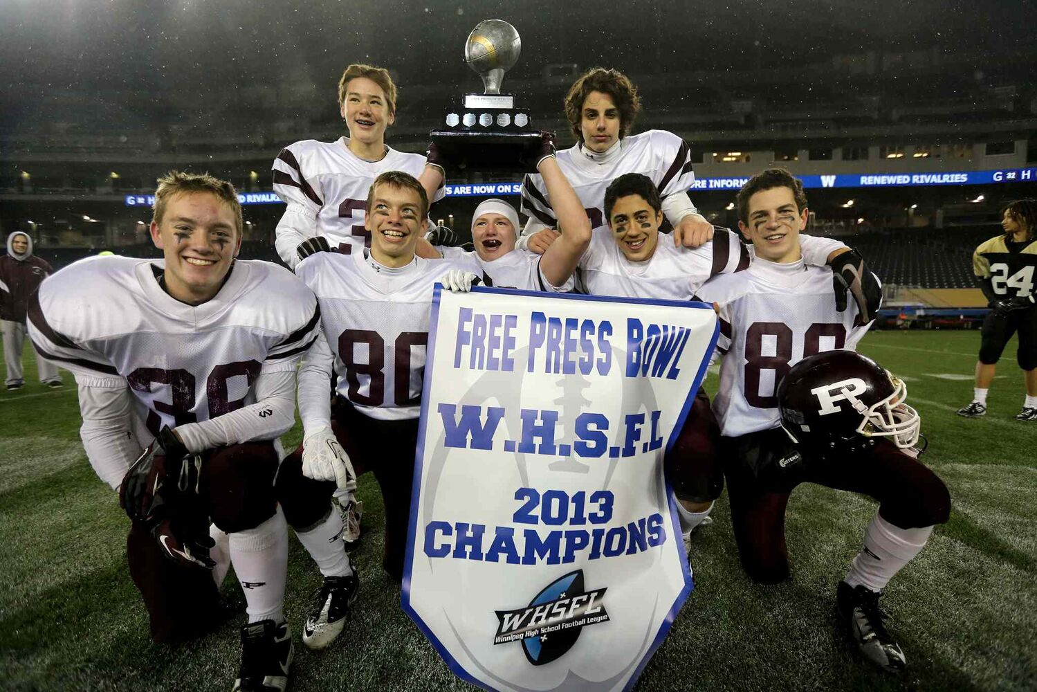 The St.Paul's Crusaders AA football team celebrates their Free Press Bowl Championship victory over the Garden City Fighting Gophers. (Trevor Hagan / Winnipeg Free Press)