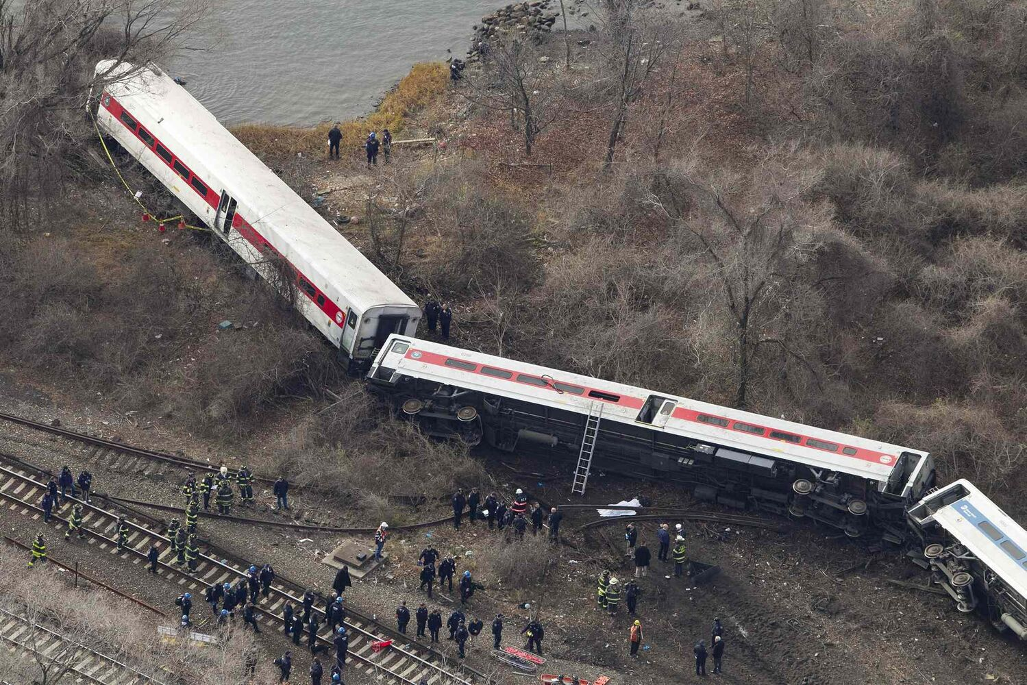 Emergency rescue personnel work the scene of the Metro-North passenger train derailment.