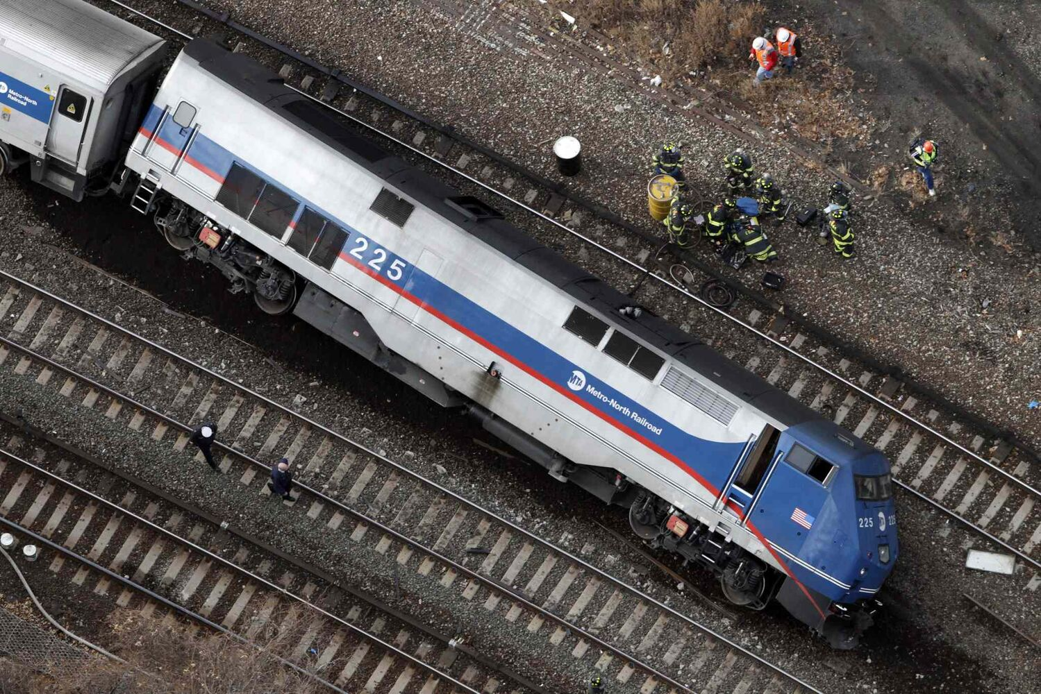 A Metro-North locomotive lies on its side after derailing Sunday in the Bronx borough of New York. (Mark Lennihan / The Associated Press)