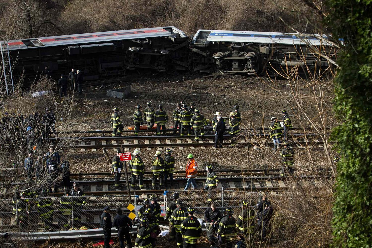 Emergency personnel respond to the scene of a Metro-North passenger train derailment. (John Minchillo / The Associated Press)
