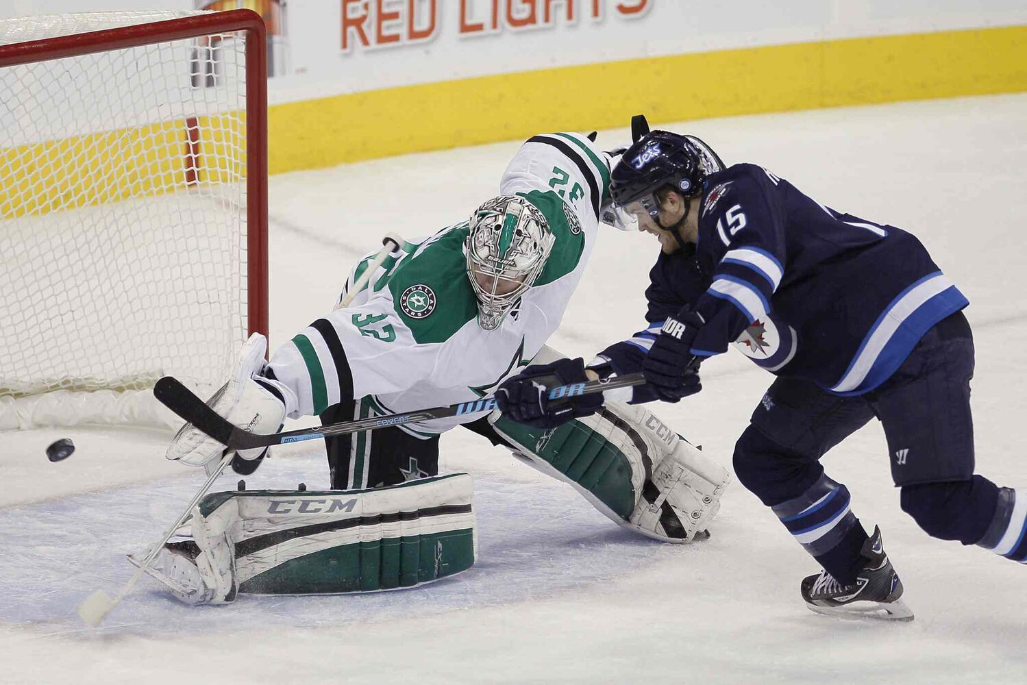 Winnipeg Jets forward Matt Halischuk (right) scores on Dallas Stars goaltender Kari Lehtonen during the first period.