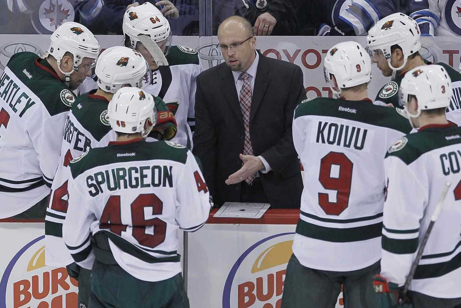 Minnesota Wild head coach Mike Yeo talks to his players during a third-period timeout.