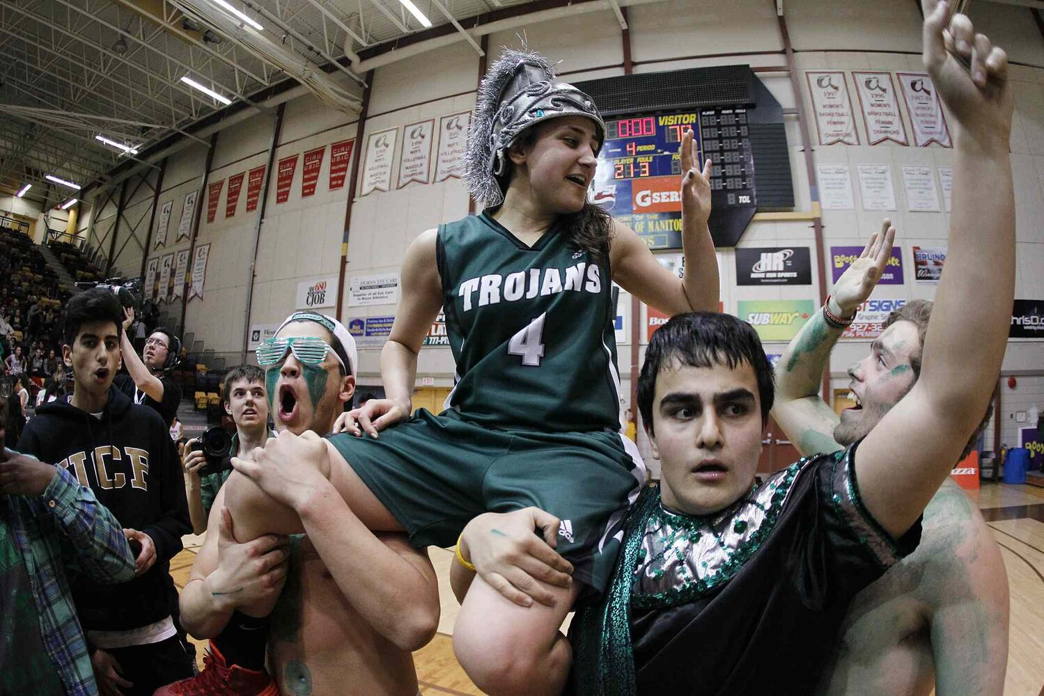 Supporters carry Vincent Massey Trojans player and tournament MVP Atoosa Jalayeri after the big win. (JOHN WOODS / WINNIPEG FREE PRESS)