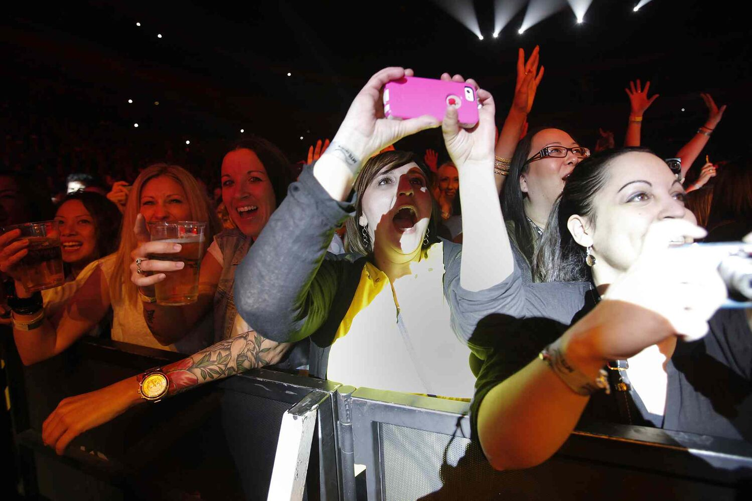 A fan takes a picture while the Backstreet Boys perform at the MTS Centre Sunday night. (John Woods / Winnipeg Free Press)