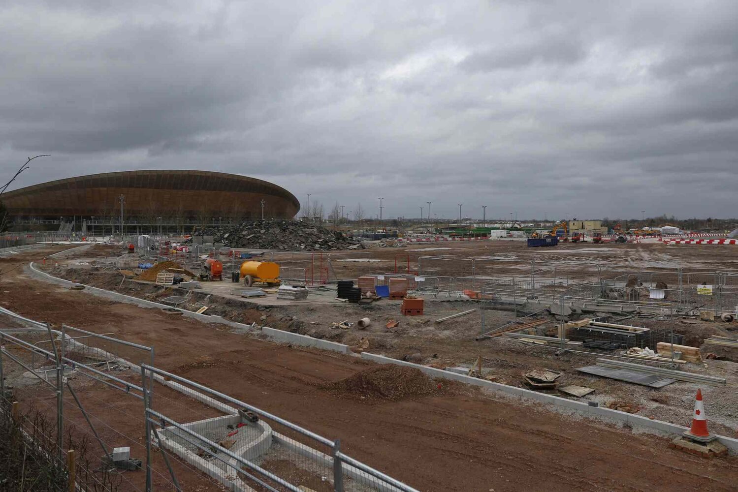 A view of the construction site in Queen Elizabeth Olympic Park in east London. The Games' Velodrome is seen at left. London continues to bask in the success of the most recent Summer Games, but the Olympic legacy is difficult to determine. The flagship venue, renamed the Queen Elizabeth Olympic Park, is being converted into a massive park as big as London's famous Hyde Park, complete with wildlife habitats, woods and sports facilities. The first part of the ambitious project will begin to open to the public in April. The 80,000-seat Olympic Stadium at the center of the park has been troubled by controversy since even before the games, and its post-games use was the subject of months of legal wrangling. The stadium is now being converted into a soccer venue and the home of the West Ham soccer club, with an expected price tag of $323 million. Many argue taxpayers should not have to fund a Premier League club, though officials insist that the stadium will continue to host other major sporting events, including the Rugby World Cup in 2015.  (Lefteris Pitarakis / The Associated Press)