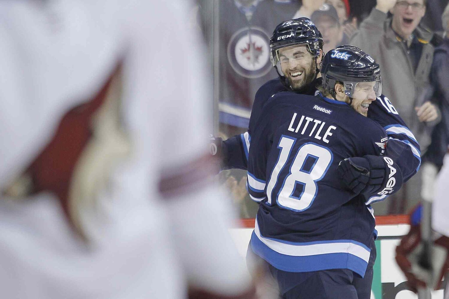Winnipeg Jets' Bryan Little (18) and Andrew Ladd (16) celebrate Little's second-period goal against the Phoenix Coyotes Thursday.