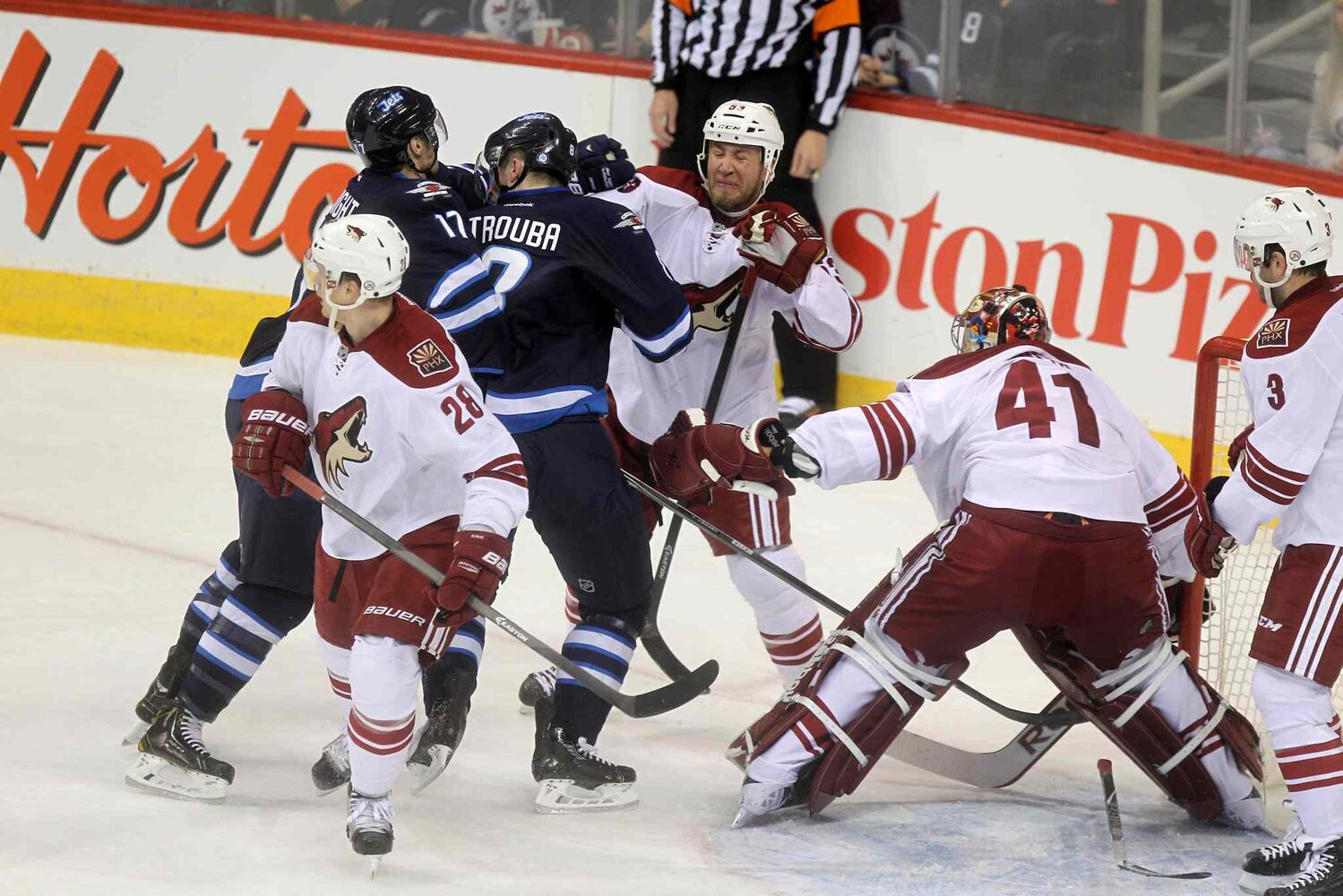Phoenix Coyotes' Derek Morris (53) fights with Winnipeg Jets players during the first period of Thursday's game. (Ruth Bonneville / Winnipeg Free Press)