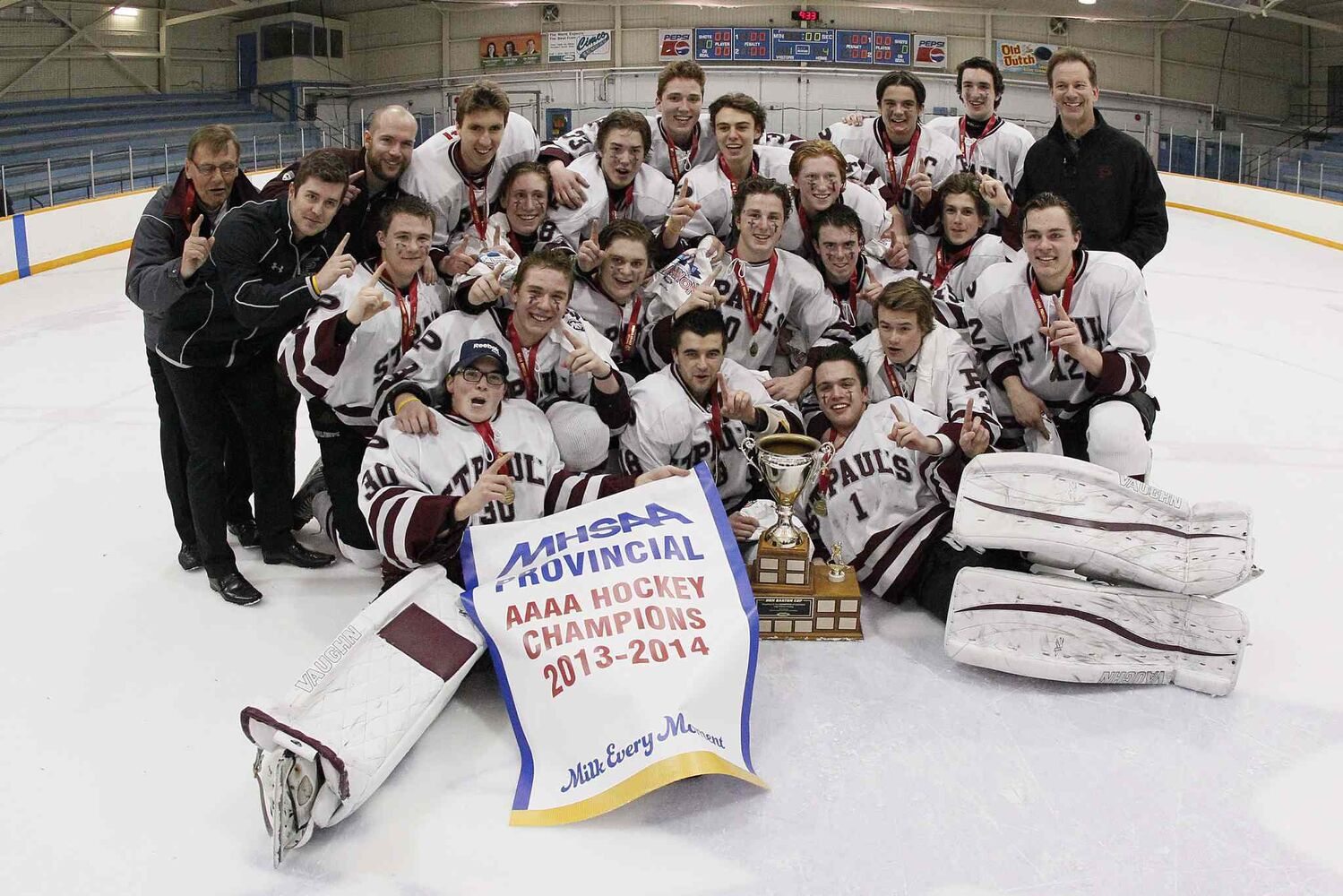 The provincial champion St. Paul's Crusaders hockey team pose for a trophy shot. (JOHN WOODS / WINNIPEG FREE PRESS)