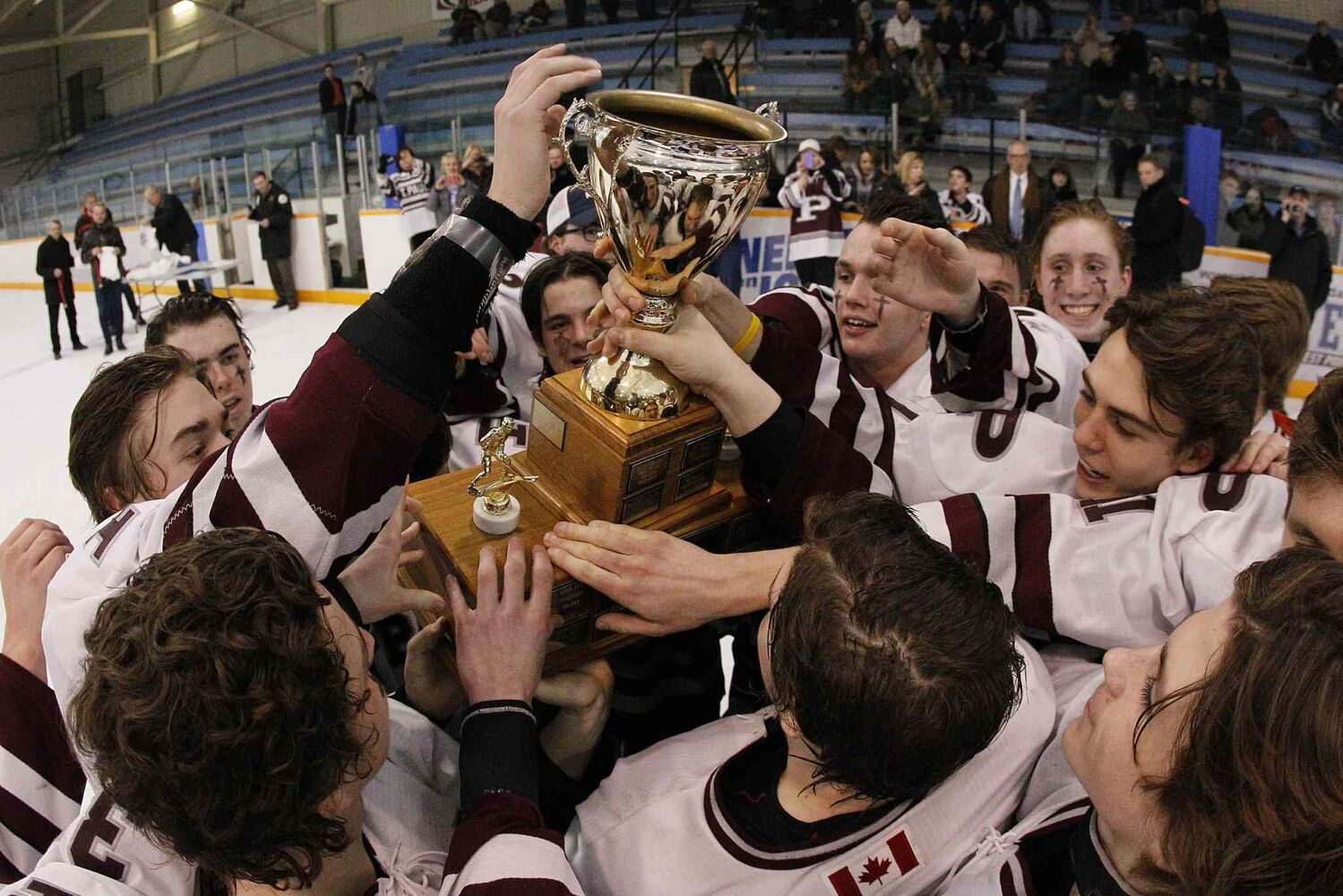 St. Paul's Crusaders players celebrate a 4-1 win over the River East Kodiaks in the AAAA Provincial High School Hockey Championship at St. James Civic Centre Monday night. (JOHN WOODS / WINNIPEG FREE PRESS)