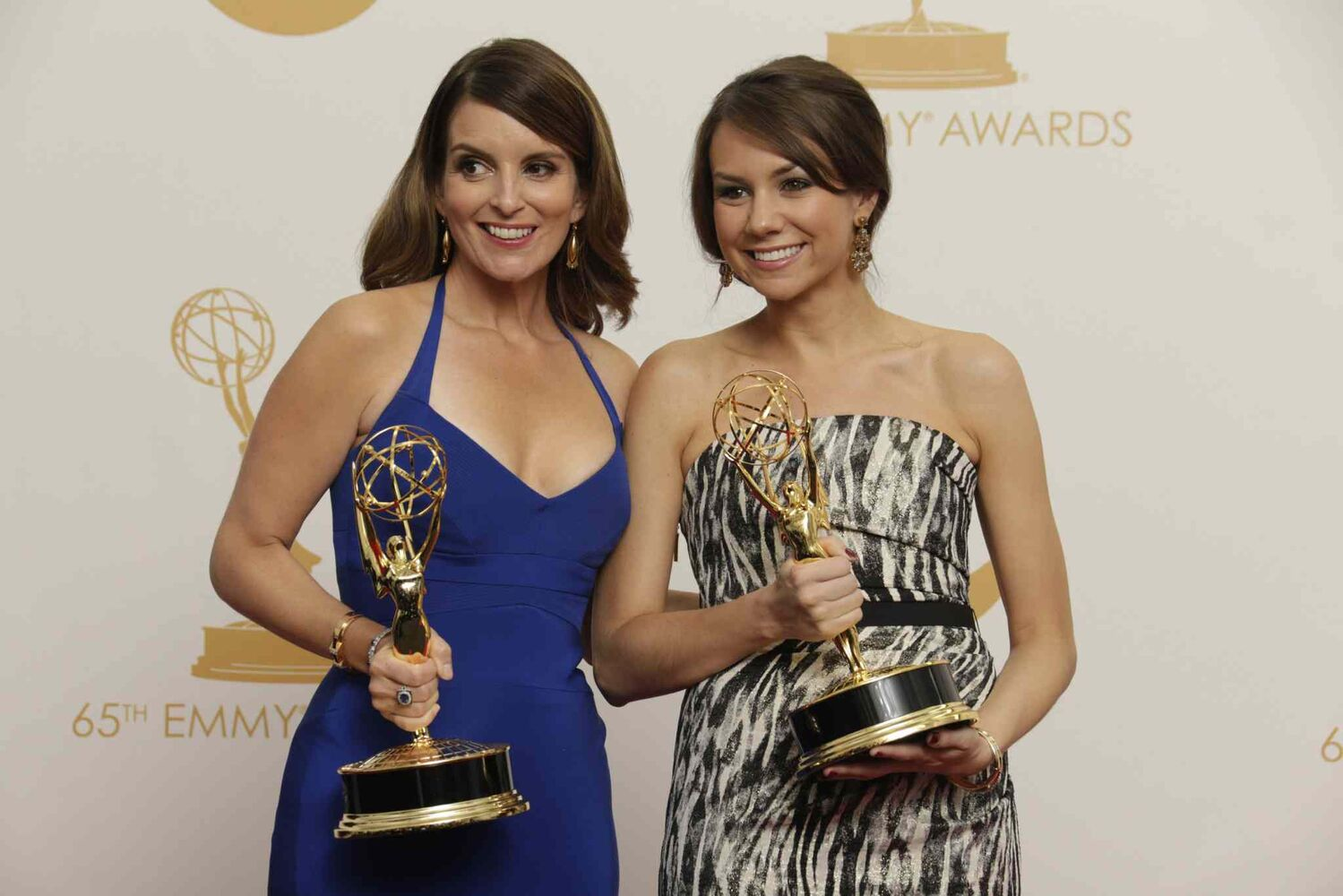 Tina Fey, left, and Tracey Wigfield won the award for outstanding writing for a comedy series for their work on 30 Rock at the 65th Primetime Emmy Awards Sunday   (Tribune Media MCT)