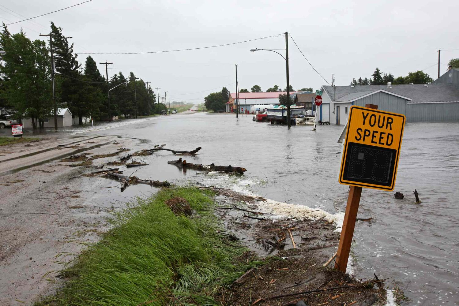 Water overruns Highway 256 in Cromer. (Tim Smith/Brandon Sun)