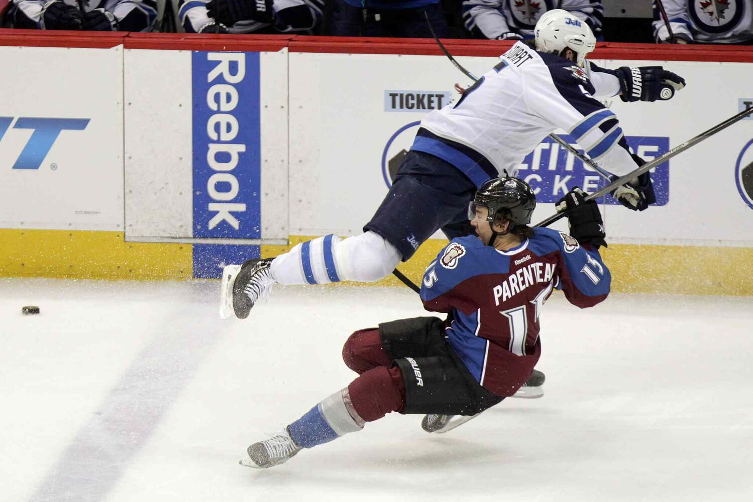 Winnipeg Jets defenceman Mark Stuart lays out the Colorado Avalanche's P.A. Parenteau during the first period.